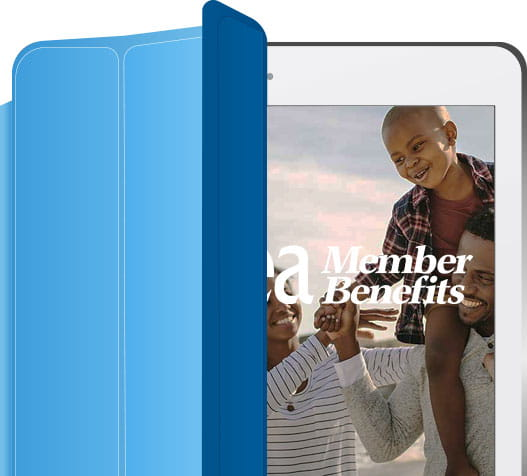 An iPad with a photo of a father, mother, and son on a beach