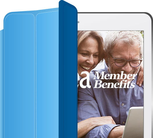 An iPad with a photo of a man and woman looking at a computer