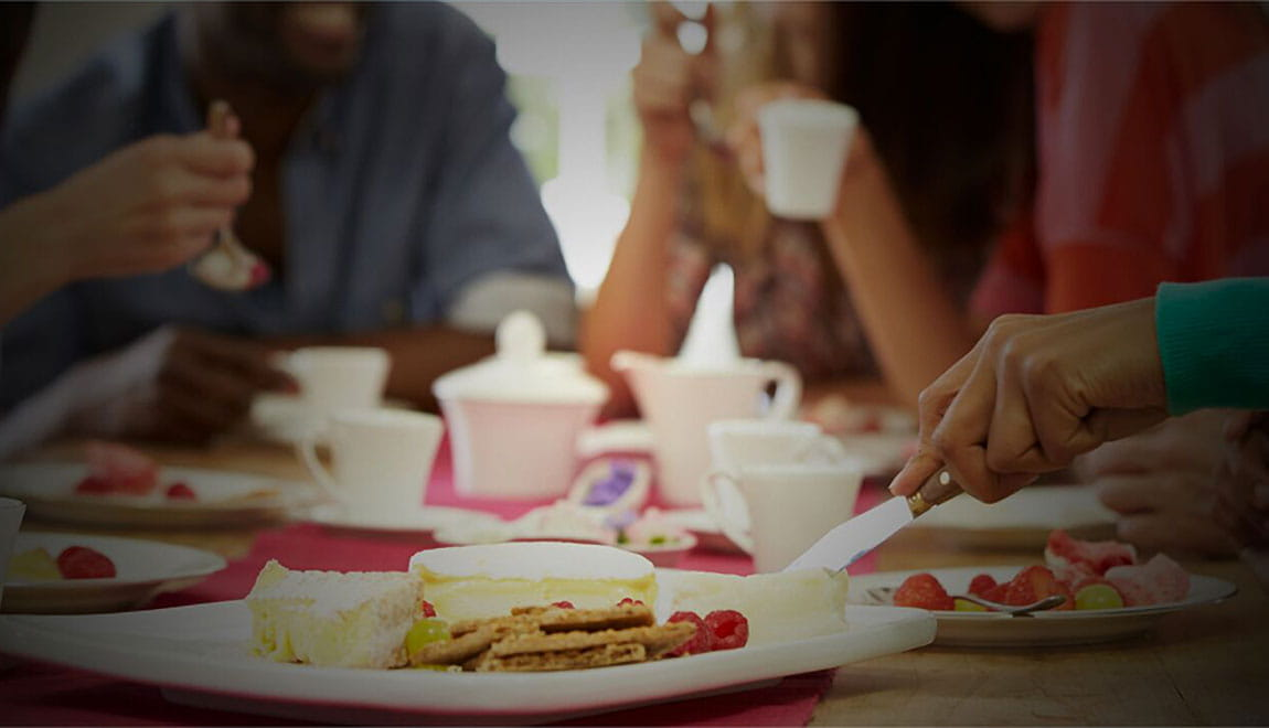 People sitting together eating