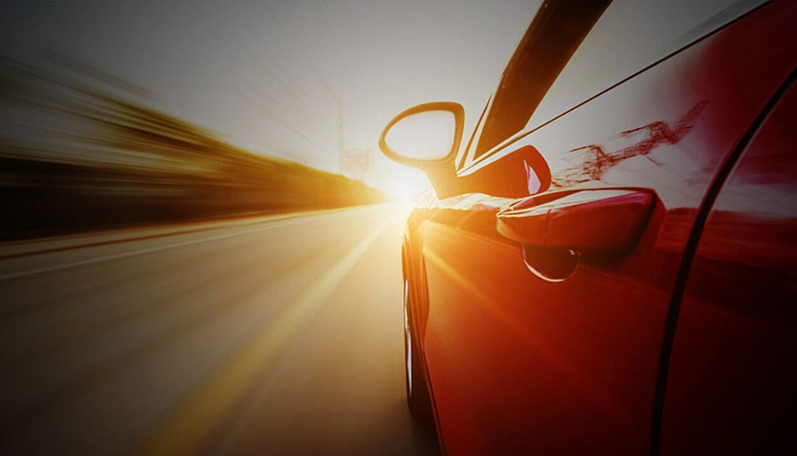 Volkswagen car driving into the sunset