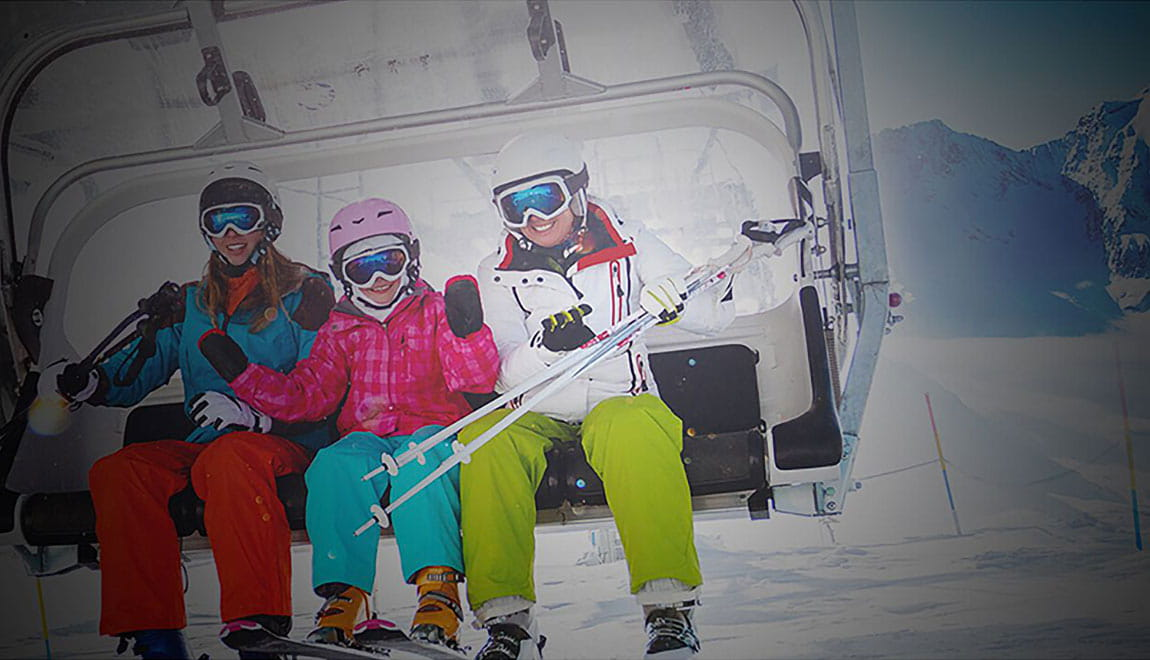 Family riding a chairlift at a ski resort