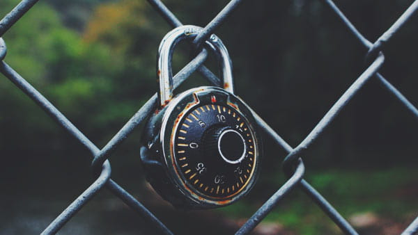 padlock locked to chainlink fence