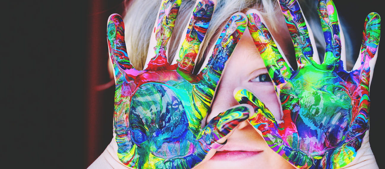 girl with paint swirls on palms