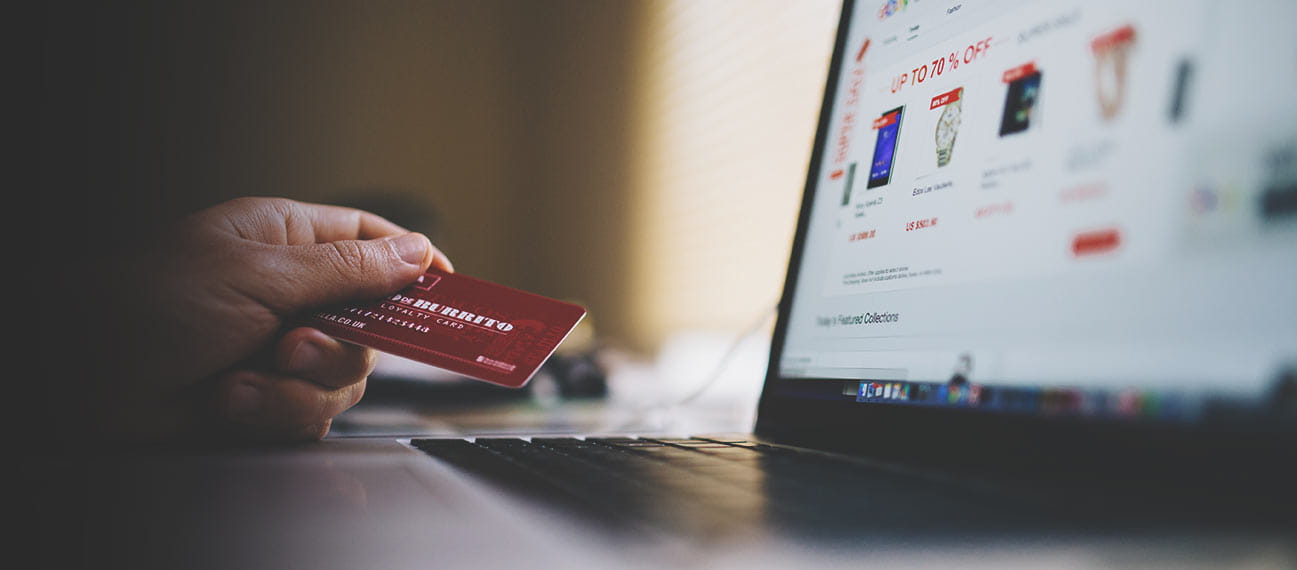 Photo of person using their credit card an an e-commerce website