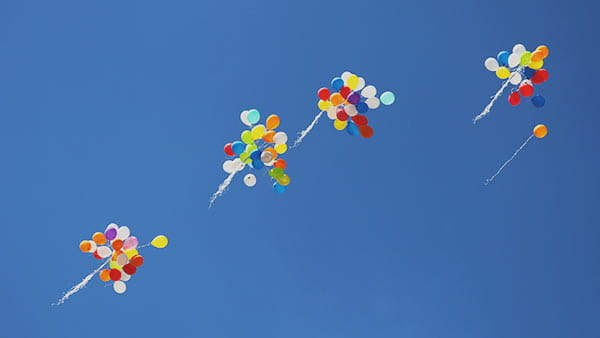 groups of balloons in the sky