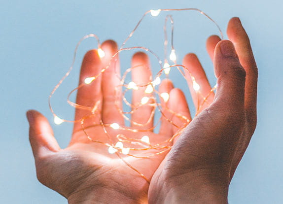Technical Audit hero: photo of string lights in man's hand