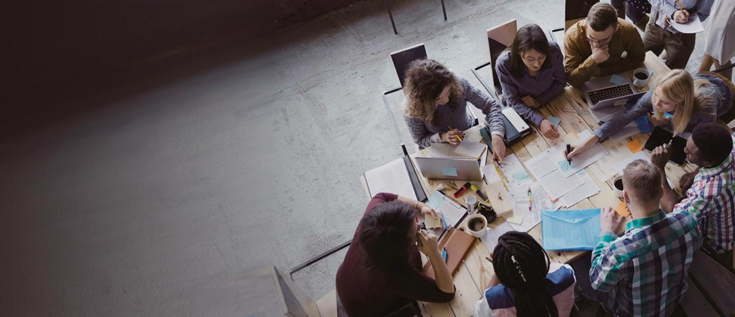 Office workers collaborating around a table